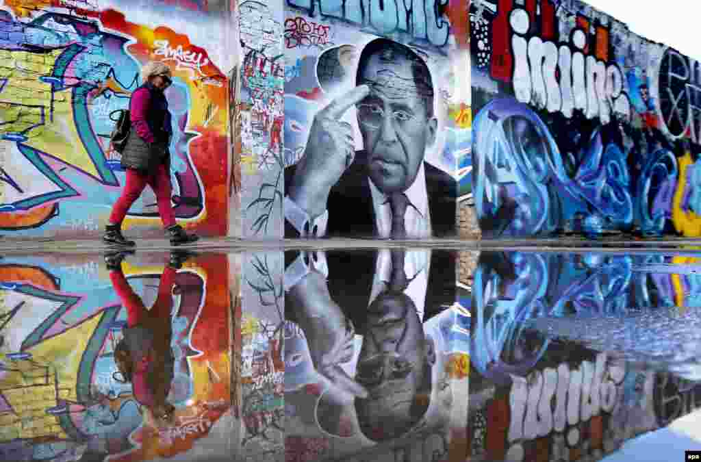 A woman walks by graffiti in Moscow depicting Russian Foreign Minister Sergei Lavrov by Russian artist Daniil Sudnev. Sudnev created the graffiti to mark Lavrov's 67th birthday. (epa/Yuri Kochetkov)