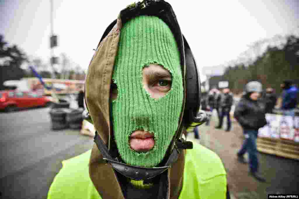 A masked antigovernment demonstrator