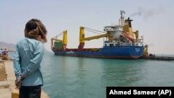 FILE: A Yemeni man looks at a World Food Program ship at the port of Aden, Yemen in July 2015.