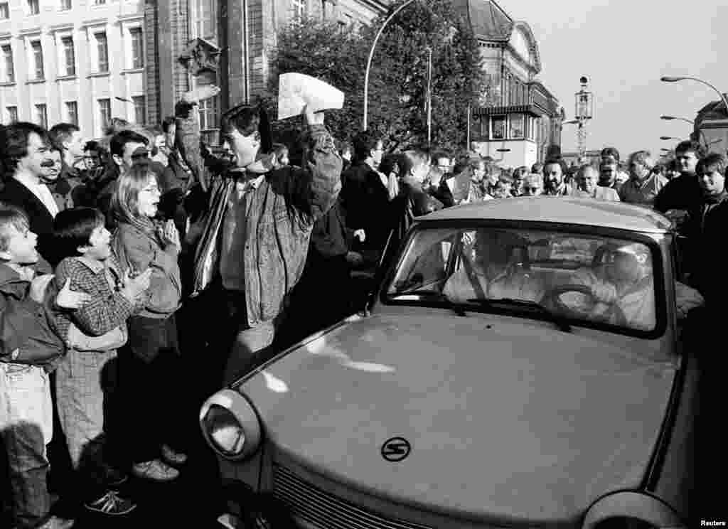 "When the wall separating East and West Germany finally fell in 1989, Trabants driving west were doused in champagne and had their Duroplast roofs thumped in celebration. The reek of the Trabant's exhaust fumes on the streets of reunified Berlin was dubbed ""the perfume of freedom."""