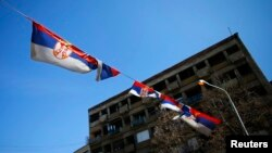 Kosovo -- Serbian flags are seen near the main bridge in the ethnically divided town of Mitrovica, 20Mar2013