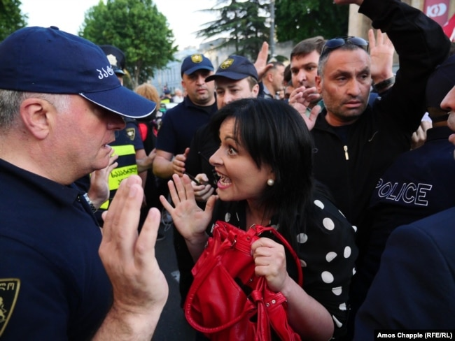 A protester argues with police outside the city's old parliament building on the evening of June 3.