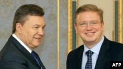 Ukrainian President Viktor Yanukovych (left) and European Enlargement Commissioner Stefan Fuele in Kyiv on February 8.