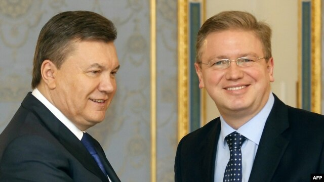 Ukrainian President Viktor Yanukovych (left) and European Enlargement Commissioner Stefan Fuele in Kyiv on February 8.