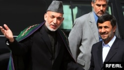 Afghan President Hamid Karzai (left) welcomes his Iranian counterpart Mahmud Ahmadinejad to Kabul.