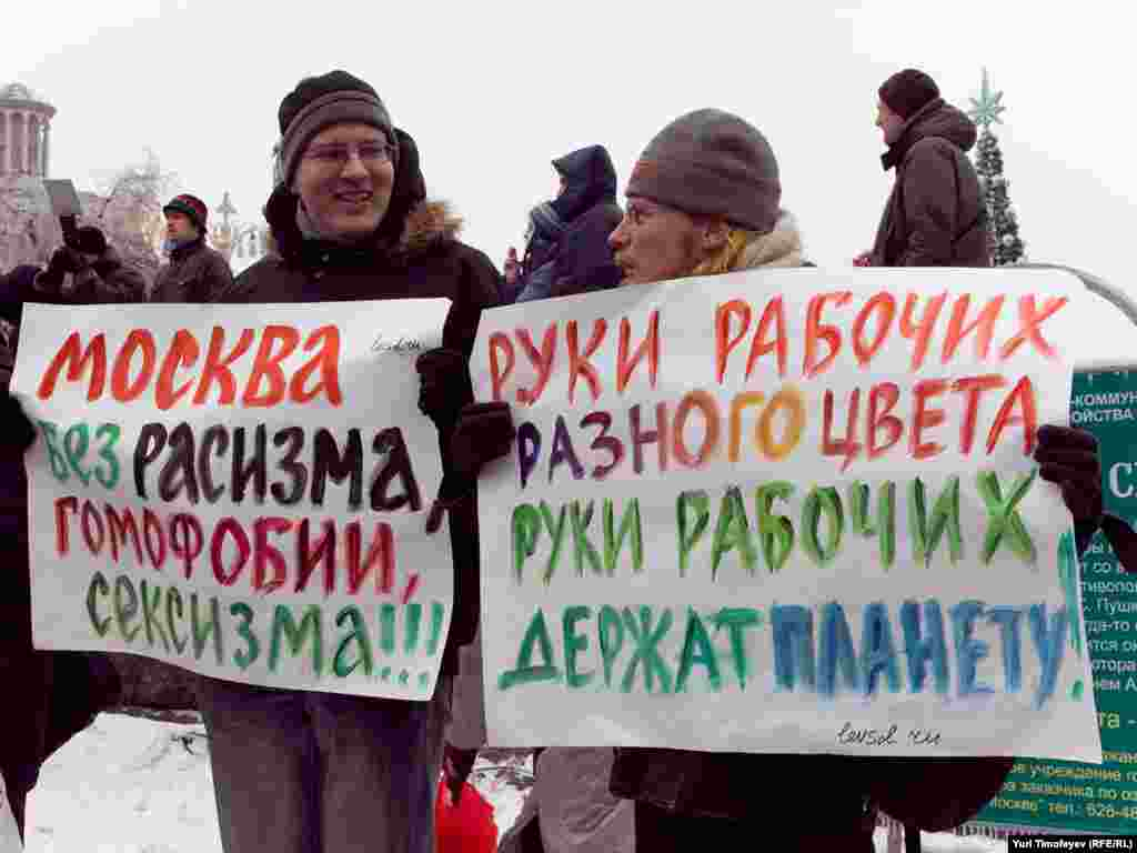 """Moscow without racism, homophobia, and sexism"" (left) and, ""Hands off workers of different colors. Support the planet."""
