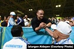 Дисквалифицированный казахстанский спортсмен Илья Ильин находится на Олимпиаде в Рио в качестве зрителя. Рио-де-Жанейро, 12 августа 2016 года.