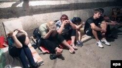 Сім'я ховається в підвалі свого будинку, який вони адаптували під бомбосховище, 29 липня 2014 року
