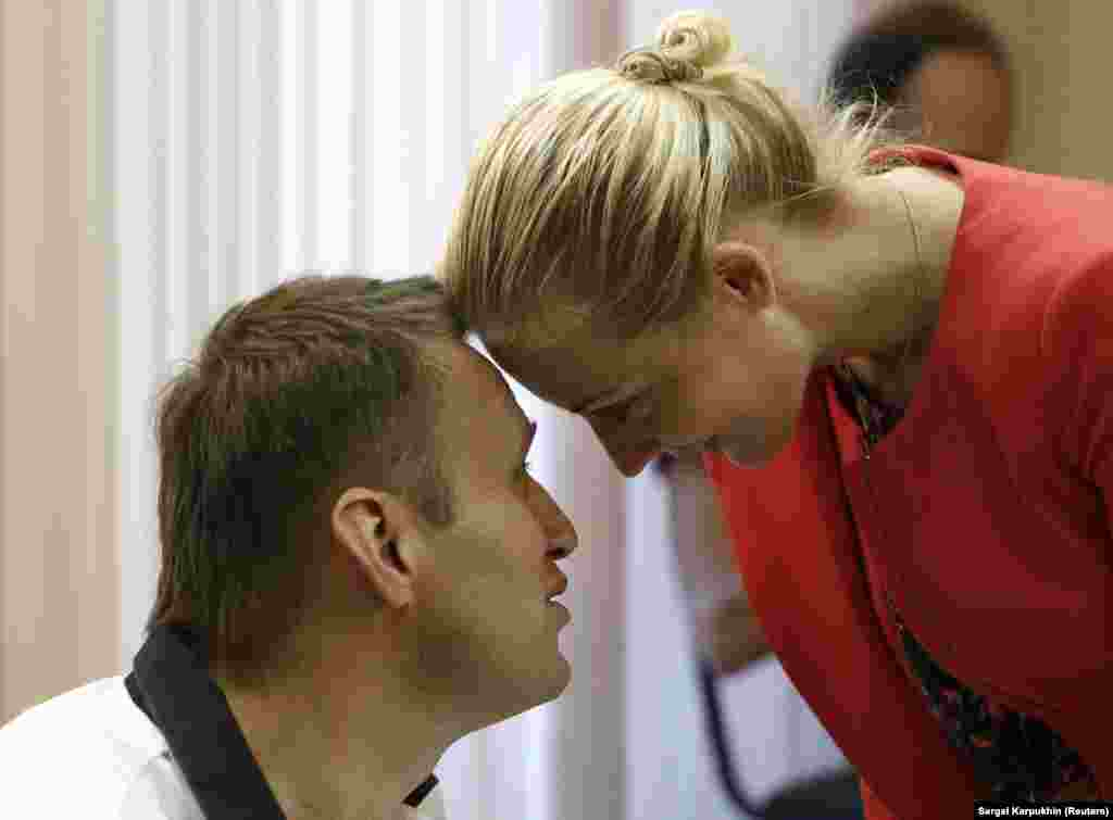 Navalny and his wife, Yulia, during a break in court proceedings in Kirov in July 2013. Navalny was charged with stealing 16 million rubles ($500,000) from a state timber firm. He rejected the charges as trumped up. The court handed down a five-year prison term that was later reduced to a suspended sentence after widespread public protests.