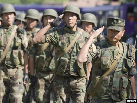 Kyrgyz Army soldiers march in formation in  the city of Osh on June 29.
