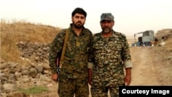 Colonel Fashad Hasounizadeh (right) was killed in southern Syria, one of three senior commanders to die there recently.