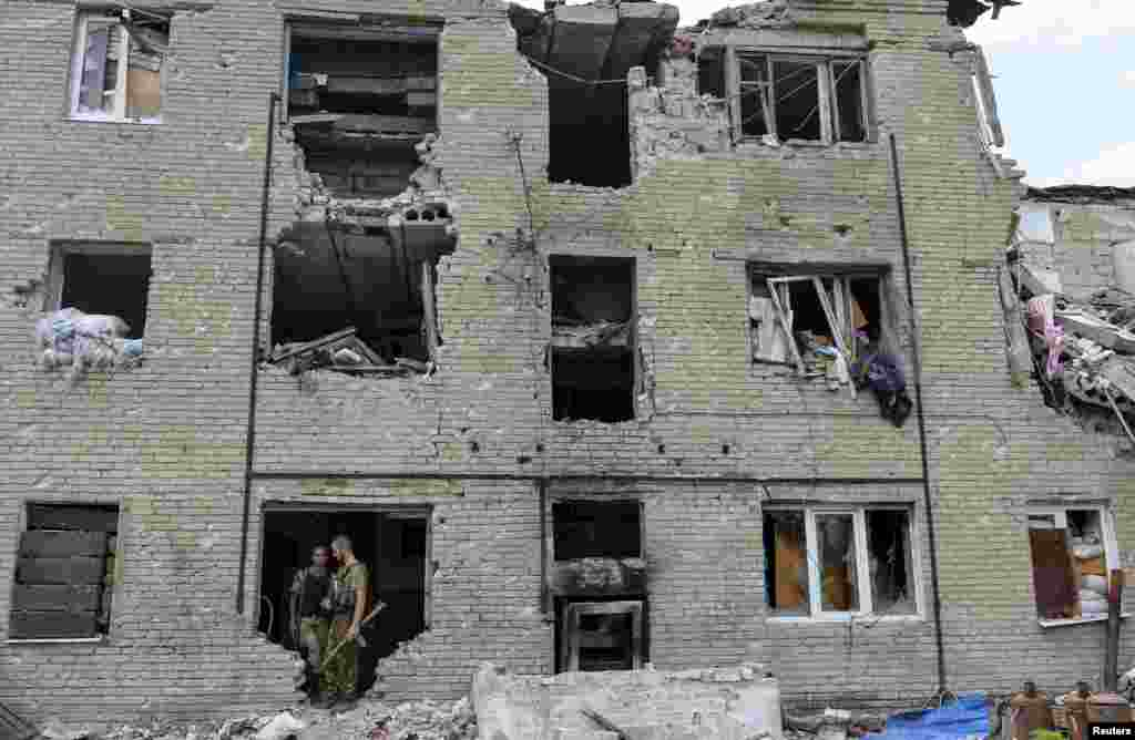 Members of the Ukrainian armed forces stay at a building damaged in fighting with pro-Russian separatists in the village of Pisky, near Donetsk. (Reuters/Oleksandr Klymenko)