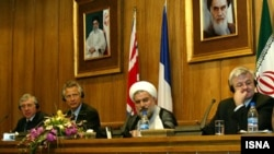 Iranian President Hassan Rohani has previously served as Iran's top nuclear negotiator (second from right), here with British Foreign Secretary Jack Straw (left), French Foreign Minister Dominique de Villepin (second left), and German Foreign Minister Joschka Fischer (right) during nuclear talks in 2003.
