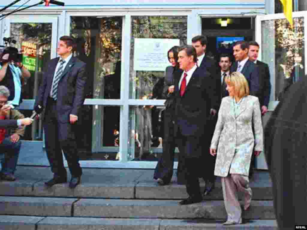 President Viktor Yushchenko leaves a Kyiv polling station with his wife, Katerina Chumachenko (front), and his daughter, Vitalina (behind him). Yushchenko signed a decree on April 2 dissolving parliament and ordering new elections