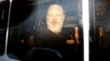 U.K. -- WikiLeaks founder Julian Assange is seen in a police van, after he was arrested by British police, in London, Britain April 11, 2019.