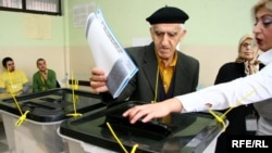 A man casts his vote at a polling station in Kosovo's capital, Pristina, on November 15.