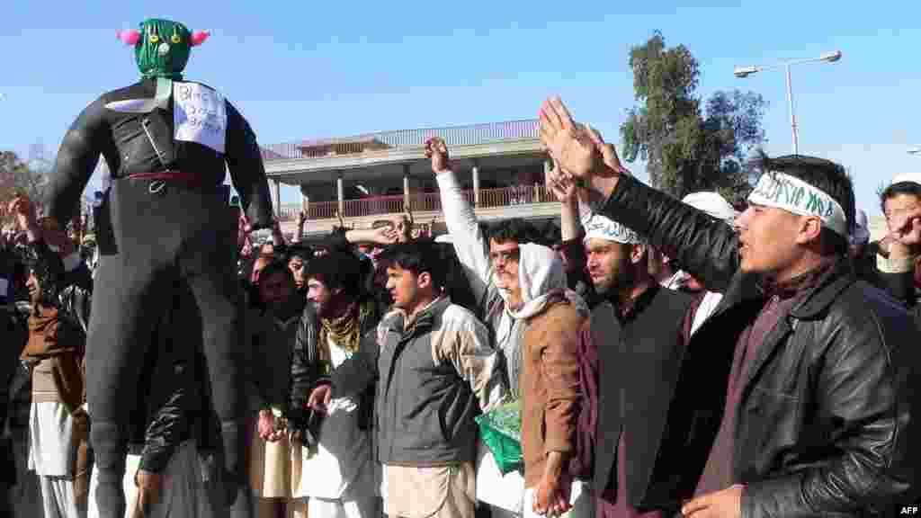 Demonstrators parade an effigy of U.S. President Barack Obama as they shout anti-U.S. slogans during a protest in Jalalabad on February 22 against the reported Koran desecrations.