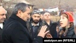 Armenia - Video screenshot of Syunik Governor Surik Khachatrian (L) arguing with Mariam Sukhudian (R) and other environmental activists in Kajaran village, 18Dec2011.