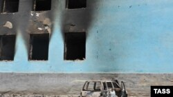 A burned-out house following ethnic clashes in Osh
