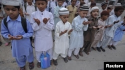 Pakistan -- Students of a madrasa (religious school) pray before going into a classroom at Karachi's Memon Mosque, 24Jun2012