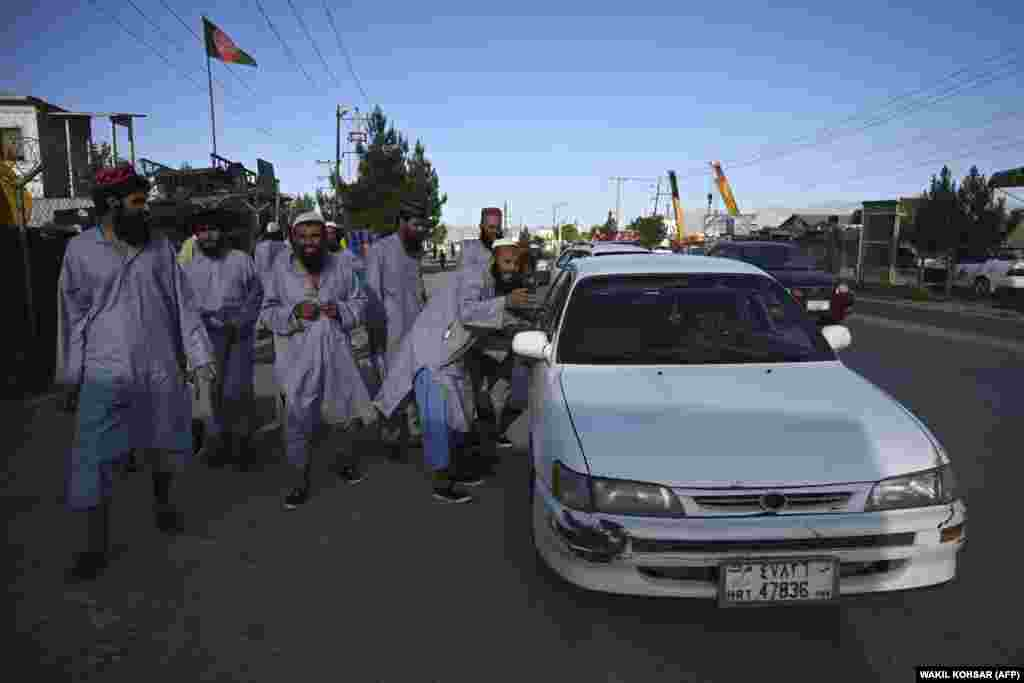 Former Taliban prisoners stop a taxi in the Afghan capital, Kabul, on May 26 -- a day after their release from Bagram prison.