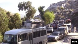 People fleeing Mingora earlier this month