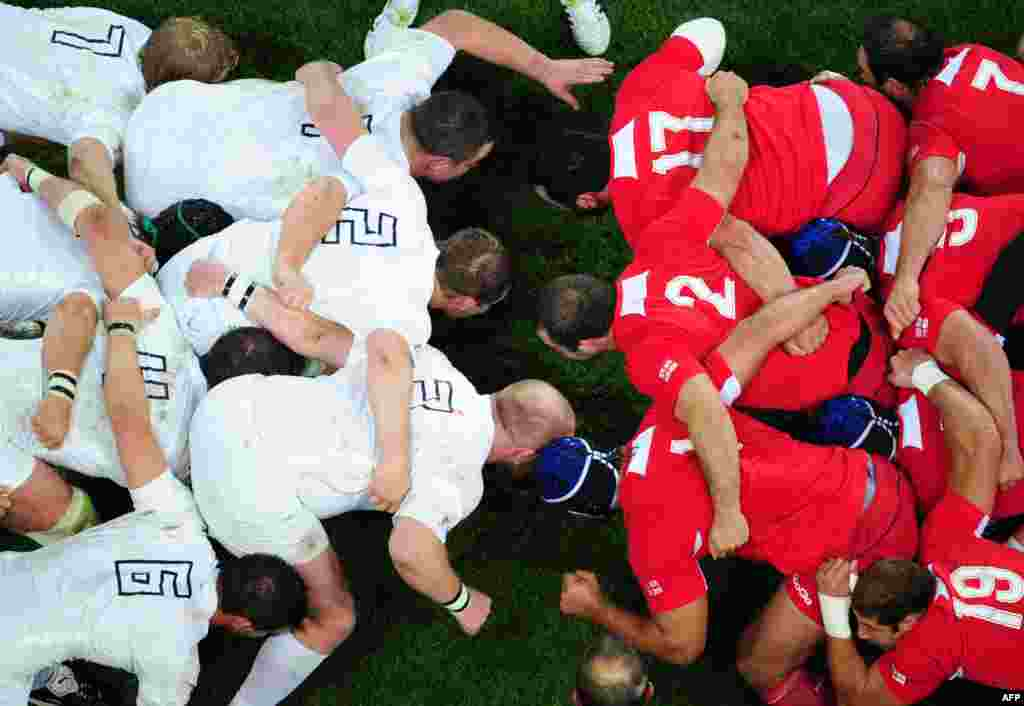 English (in white) and Georgian players prepare to scrummage during a Rugby World Cup pool match at Otago Stadium in Dunedin, New Zealand, on September 18. (Photo by Martin Bureau for AFP)