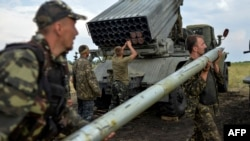 Ukrainian soldiers charge a Grad multiple rocket launcher system near the eastern city of Shchastya in August 2014.