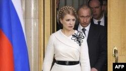 Під час зустрічі Юлії Тимошенко і Володимира Путіна. 29 квітня 2009 р.
