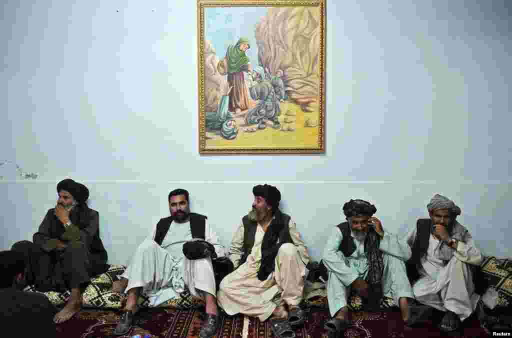 Pashtun leaders listen to President Hamid Karzai speak at a meeting with tribal leaders in Kandahar in June 2010.