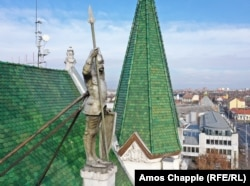 Roland, a legendary eighth-century knight, stands atop the mayor's building in Ujpest, a suburb in northern Budapest.