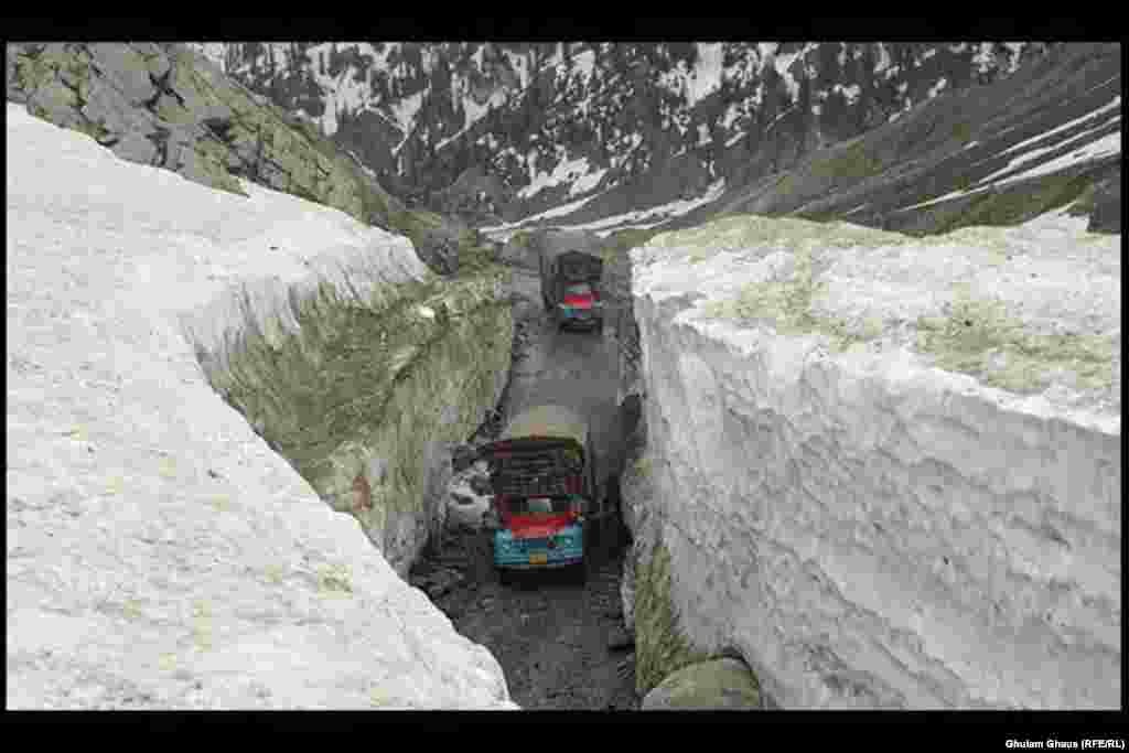 Trucks navigate a mountain road as snow and rain wreak havoc in Pakistan's northern Kyber Pakhtunkhwa and FATA regions.