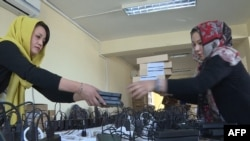 Election campaign workers prepare biometric devices in Kabul.