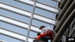 Alain Robert scales the 828-meter Burj Khalifa in Dubai.