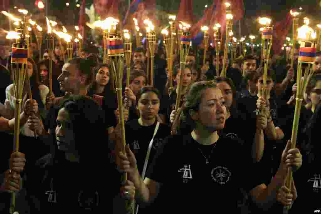 People in Yerevan take part in a torchlight procession to mark the anniversary of mass killings of ethnic Armenians in Ottoman-era Turkey on April 24. (AFP/Karen Minasyan)