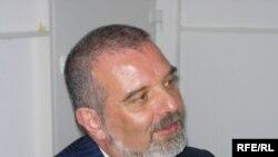Акрам Хузам