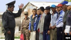 Uzbekistan -- 18-year-old boys listen to an Uzbek army major at a meeting point for new recruits in Termez, a small town at the Uzbek-Afghan border, 16Oct2001