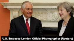 Britain's Prime Minister Theresa May greets U.S. Secretary of State Rex Tillerson at 10 Downing street in London, September 14, 2017