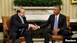 U.S. President Barack Obama meets with Pakistani Prime Minister Nawaz Sharif in the Oval Office of the White House in Washington on October 22.