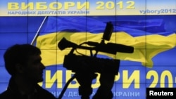 A cameraman works at a demonstration of a system to monitor the voting during the Ukrainian parliamentary election, in Kiev October 24, 2012.