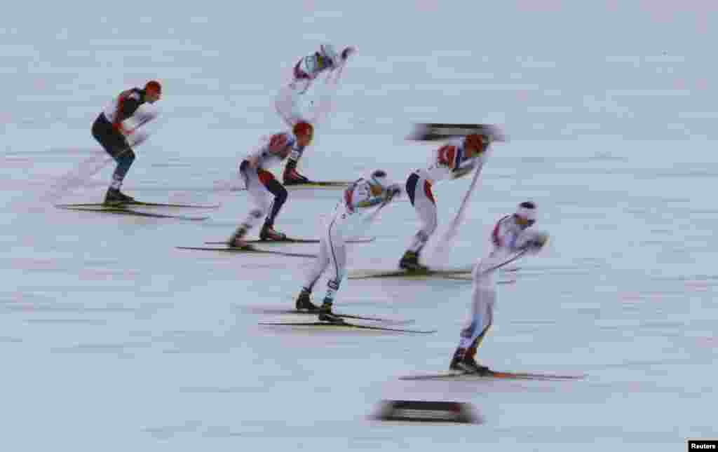 Norway's Ola Vigen Hattestad (2nd right) and Sweden's Teodor Peterson (right) and Emil Joensson (3rd right) compete in the men's cross-country sprint final.
