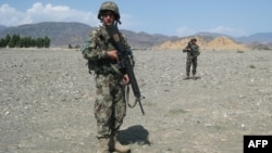 Soldiers from the Afghan National Army (ANA) patrol the vicinity of Jalalabad.
