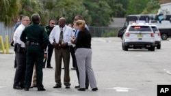 "Law-enforcement authorities converge at the scene of a shooting incident in Orlando, Florida, which they said resulted in ""multiple fatalities."""