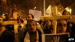 Egyptian Coptic Christians demonstrate outside the state radio and television building in central Cairo on March 8 to protest the burning of a church after deadly clashes between Christians and Muslims in a southern city.
