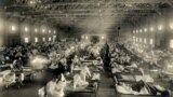 U.S. -- Beds with patients in an emergency hospital in Camp Funston, Kansas, in the midst of the influenza epidemic, circa 1918
