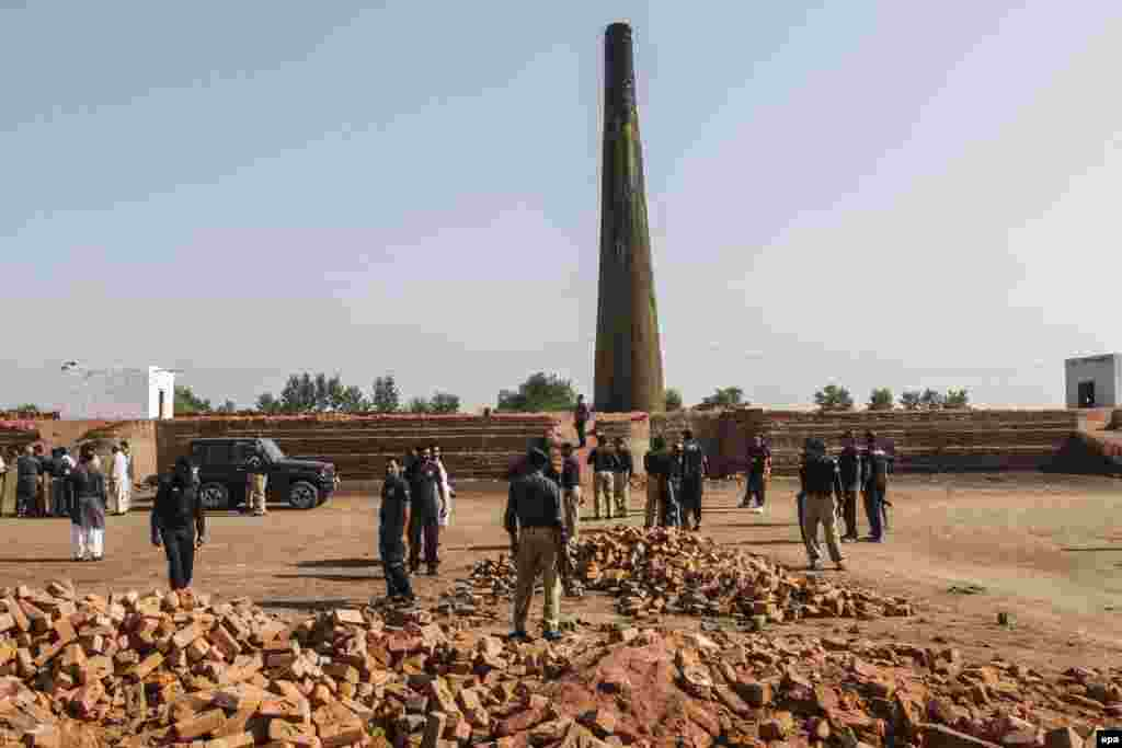 Pakistani police inspect the brick kiln where a Christian couple was beaten to death and then cremated after they were accused of desecrating the Koran. (epa/Rahat Dar)