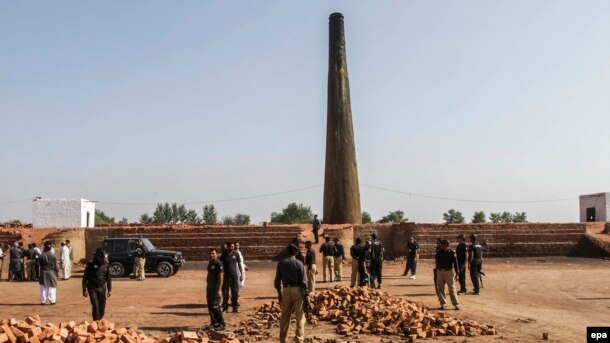Pakistani Police inspect the brick kiln where a Christian couple was burned alive for alleged blasphemy in November 2014.