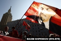 A portrait of former Soviet leader Vladimir Lenin is held aloft during a protest rally against a government-proposed pension-reform plan in Moscow on September 2.