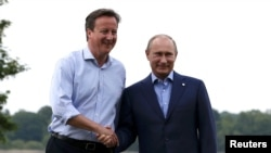 U.K. Prime Minister David Cameron with Russian President Vladimir Putin (file photo)