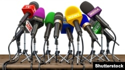 GENERIC – Press conference or interview concept. Microphones of different mass media, radio, tv and press prepared for conference meeting. 3d illustration.